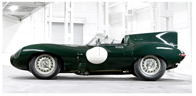 Hunter Green Jagaur D-Type in a room with a white background