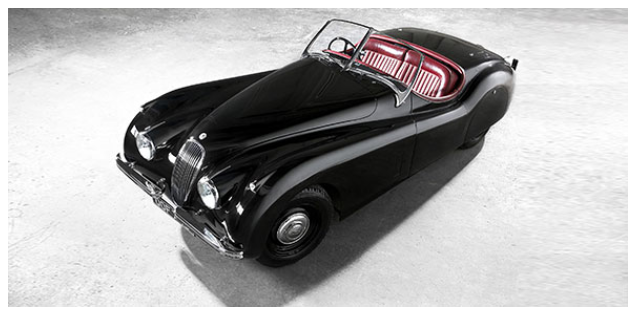 A black Jaguar XK120 with red seats viewed from the top